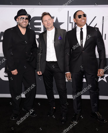 Mark Calderon and from left, Martin Kember and Kevin Thornton of musical group Color Me Badd pose in the press room at the BET Awards at the Nokia Theatre, in Los Angeles