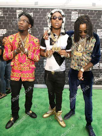 "Stock Image of Migos (l-r: Kiari ""Offset"" Cephus, Kirshnik ""Takeoff"" Ball and Quavious ""Quavo"" Marshall) was seen arriving at the 2014 BET Hip Hop Awards held at the Atlanta Civic Center, in Atlanta, Ga"
