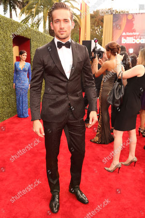 Mauricio Henao arrives at the 2014 Billboard Latin Music Awards on at the BankUnited Center in Coral Gables, Fla