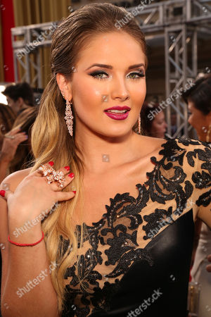 Kimberly Dos Ramos arrives at the 2014 Billboard Latin Music Awards on at the BankUnited Center in Coral Gables, Fla