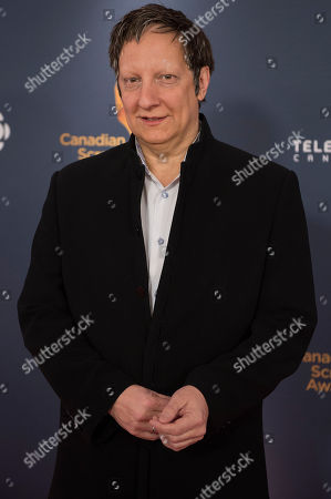 Director Robert Lepage poses on the red carpet at the 2014 Canadian Screen Awards on in Toronto, Canada