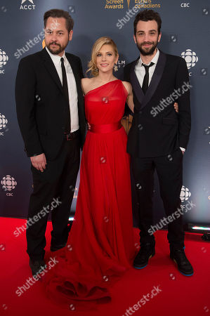 Writer/Director Jonathan Sobol, Actress Kathyrn Winnick and Actor Jay Baruchel pose on the red carpet at the 2014 Canadian Screen Awards on in Toronto, Canada