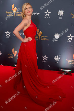Stock Photo of Actress Kathryn Winnick poses on the red carpet at the 2014 Canadian Screen Awards on in Toronto, Canada