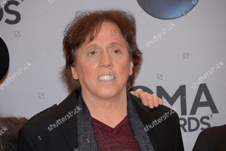 John McFee, of the musical group The Doobie Brothers, arrives at the 48th annual CMA Awards at the Bridgestone Arena, in Nashville, Tenn