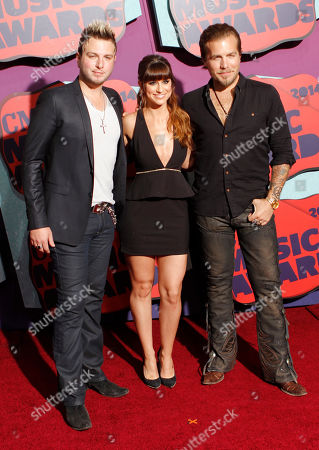 Mike Gossin, and from left, Rachel Reinert and Tom Gossin of the musical group Gloriana arrive at the CMT Music Awards at Bridgestone Arena, in Nashville, Tenn
