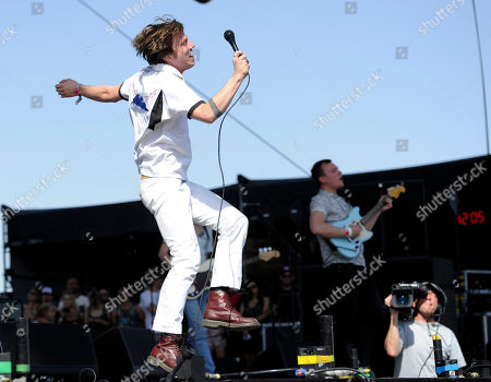 Matt Schultz, left, and his brother Brad Schultz of Cage The Elephant perform during the band's set at the 2014 Coachella Music and Arts Festival, in Indio, Calif