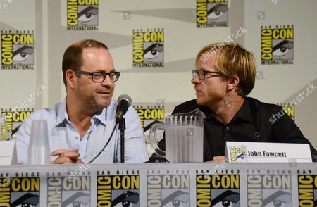 """Executive producer Graeme Manson, left, and director John Fawcett attend the """"Orphan Black"""" panel on Day 2 of Comic-Con International, in San Diego"""