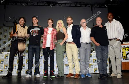 "Alexander Koch and from left, Eddie Cahill, Colin Ford, Rachelle Lefevre, Mike Vogel, Neal Baer, Dean Norris and Kevin Frazier attend the ""Under the Dome"" panel on Day 1 of Comic-Con International, in San Diego"