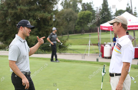 Stock Image of Mark-Paul Gosselaar, left, and Joel Gretsch participates in a tournament at the 15th Emmys Golf Classic, presented by the Television Academy Foundation, at the Wilshire Country Club in Los Angeles