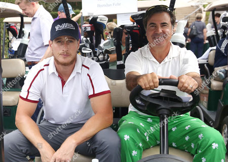 Brendan Fehr, left, and Jackie Flynn participate in a tournament at the 15th Emmys Golf Classic, presented by the Television Academy Foundation, at the Wilshire Country Club in Los Angeles