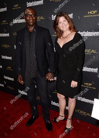 Lance Reddick, left, and Stephanie Reddick arrive at Entertainment Weekly's Pre-Emmy Party sponsored by L'Oreal Paris and Hearts On Fire at Fig & Olive in West Hollywood, Calif. on