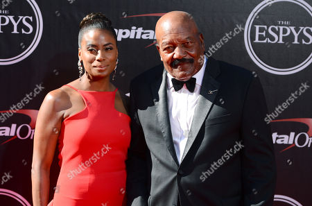 NFL legend Jim Brown, right, and Monique Brown arrive at the ESPY Awards at the Nokia Theatre, in Los Angeles