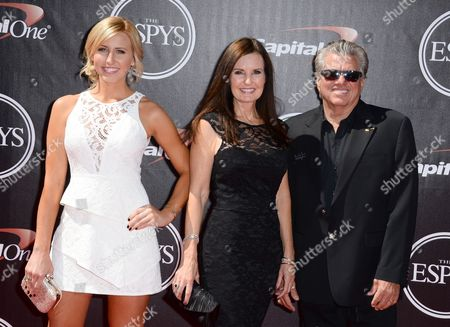 From left, Courtney Force, Laurie Force and John Force arrive at the ESPY Awards at the Nokia Theatre, in Los Angeles