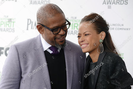 Forest Whitaker, left, and Keisha Whitaker arrive at the 2014 Film Independent Spirit Awards,, in Santa Monica, Calif