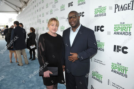 Bianca Stigter, left, and Steve McQueen arrive at the 2014 Film Independent Spirit Awards,, in Santa Monica, Calif