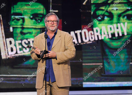 """Sean Bobbitt accepts the award for best cinematography for """"12 Years a Slave"""" on stage at the 2014 Film Independent Spirit Awards,, in Santa Monica, Calif"""