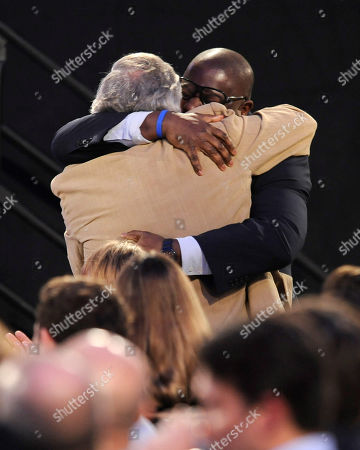 """Sean Bobbitt hugs Steve McQueen before accepting the award for best cinematography for """"12 Years a Slave"""" on stage at the 2014 Film Independent Spirit Awards,, in Santa Monica, Calif"""