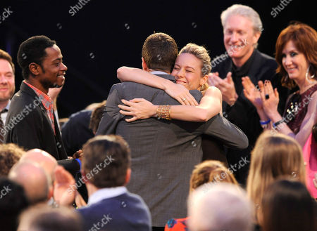 "Nat Sanders, center left, embraces Brie Larson after winning the award for best editing for ""Short Term 12"" at the 2014 Film Independent Spirit Awards,, in Santa Monica, Calif"