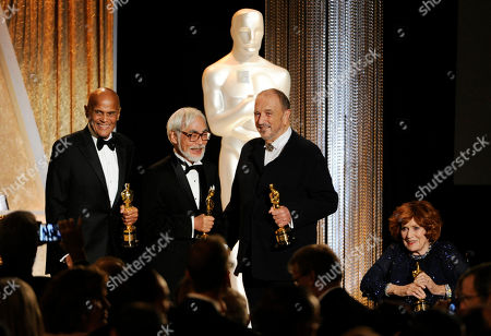 Left to right, actor/singer/activist Harry Belafonte, Japanese animator/director Hayao Miyazaki, French screenwriter Jean-Claude Carriere and actress Maureen O'Hara pose together onstage with their Honorary Oscars during the 2014 Governors Awards, in Los Angeles