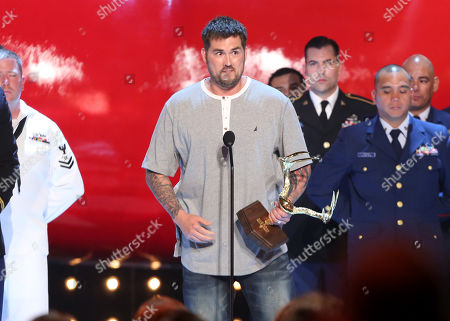 Marcus Luttrell accepts the award for troops choice onstage at the Guys Choice Awards at Sony Pictures Studios, in Culver City, Calif