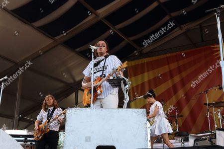Tim Kingsbury,left, Win Butler, center, and Regine Chassagne, right, of Arcade Fire perform at the 2014 New Orleans Jazz & Heritage Festival at Fair Grounds Race Course, in New Orleans