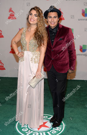 Jessi Leon, left, and Periko, of the musical duo Periko & Jessi Leon, arrive at the 15th annual Latin Grammy Awards at the MGM Grand Garden Arena, in Las Vegas