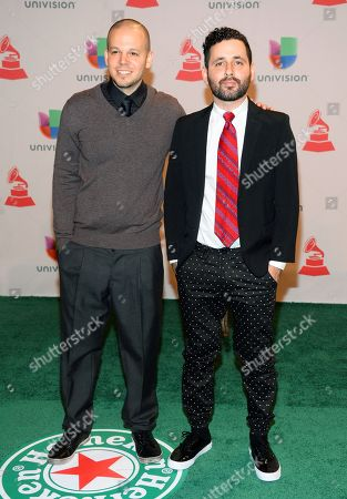 """Rene Perez Joglar, left, and Eduardo """"Visitante"""" Cabra, of the musical group Calle 13, arrive at the 15th annual Latin Grammy Awards at the MGM Grand Garden Arena, in Las Vegas"""