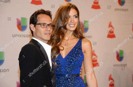 Marc Anthony, left, and Shannon De Lima arrive at the 15th annual Latin Grammy Awards at the MGM Grand Garden Arena, in Las Vegas