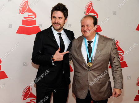 Juan Pablo Vega, left, and Julio Reyes Copello arrive at the Latin Recording Academy Person of the Year Tribute honoring Joan Manuel Serrat at the Mandalay Bay Resort and Casino, in Las Vegas
