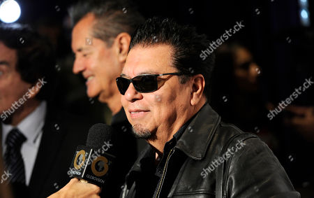 Cesar Rosas, of the musical group Los Lobos, participates in an interview at the Latin Grammys - Special Merit Awards at the Hollywood Theatre at the MGM Grand Hotel and Casino, in Las Vegas