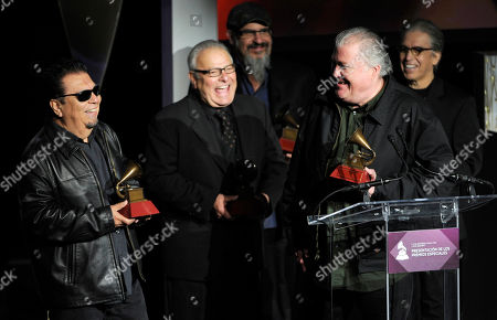Cesar Rosas, and from left, Conrad Lozano, Steve Berlin, David Hidalgo and Louie Perez, of the musical group Los Lobos, accept the 2014 Lifetime Achievement Award on stage at the Latin Grammys - Special Merit Awards at the Hollywood Theatre at the MGM Grand Hotel and Casino, in Las Vegas