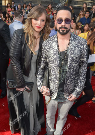 Rochelle Karidis, left, and A.J. McLean, of the musical group The Backstreet Boys, arrive at the 2014 MTV Movie Awards, on in Los Angeles