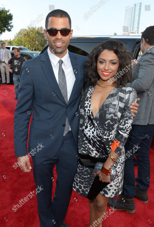 Stock Picture of Cottrell Guidry, left, and Kat Graham arrive at the 2014 MTV Movie Awards, on in Los Angeles