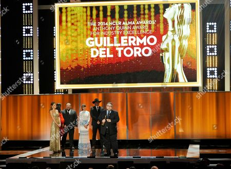 Zoe Saldana, and from left, Jorge R. Gutierrez, Mia Maestro, and Robert Rodriguez present Guillermo Del Toro with the Anthony Quinn award for excellence at the NCLR ALMA Awards at the Pasadena Civic Auditorium, in Pasadena, Calif