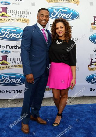 RonReaco Lee and his wife, Sheana Freeman, walked the Ford blue carpet at the 2014 Neighborhood Awards held at the Philips Arena, in Atlanta, Ga