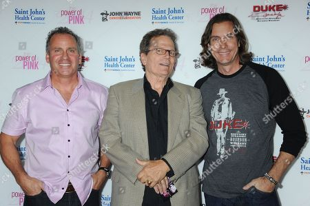Stock Photo of Ethan Wayne, from left, Patrick Wayne, and Chris Radomski arrive at 2014 Power of Pink: An Acoustic Evening With Pink And Friends at House of Blues, in Los Angeles