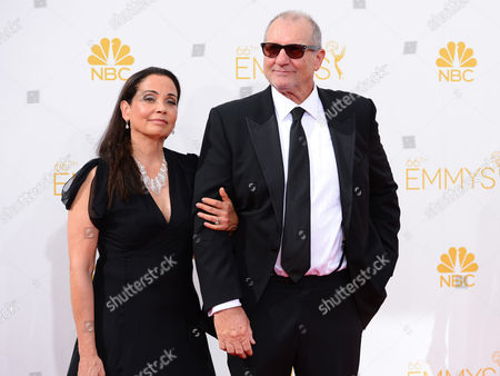 Catherine Rusoff, left and Ed O'Neill arrive at the 66th Annual Primetime Emmy Awards at the Nokia Theatre L.A. Live, in Los Angeles