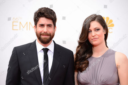 Adam Goldberg and Roxanne Daner arrive at the 66th Annual Primetime Emmy Awards at the Nokia Theatre L.A. Live, in Los Angeles
