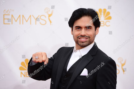 Danny Arroyo arrives at the 66th Annual Primetime Emmy Awards at the Nokia Theatre L.A. Live, in Los Angeles