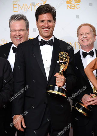 "Steve Levitan poses in the press room with the award for outstanding comedy series for ""Modern Family"" at the 66th Annual Primetime Emmy Awards at the Nokia Theatre L.A. Live, in Los Angeles"