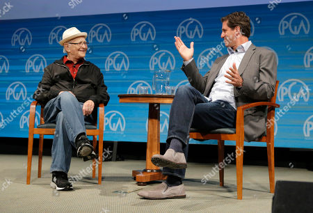 Norman Lear, left, and Steve Levitan speak on stage at the Produced By Conference - Day 2 at Warner Bros. Studios, in Burbank, Calif