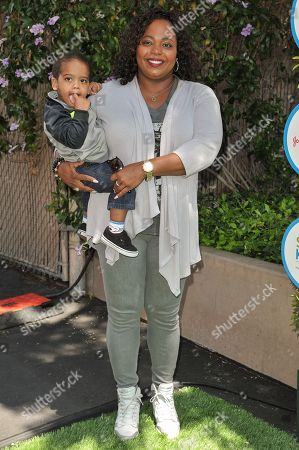 Cocoa Brown and guest arrive at the 2014 Safe Kids Day, in West Hollywood, Calif