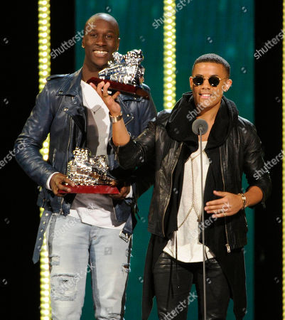 """Vincent """"Vinz"""" Dery, left, and Nicola """"Nico"""" Sereba, of Nico & Vinz, accept the award for best new artist during the 2014 Soul Train Awards at Orleans Arena, in Las Vegas"""
