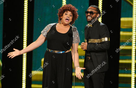 Stock Photo of Kim Coles, left, and Machel Montano speak on stage during the 2014 Soul Train Awards at Orleans Arena, in Las Vegas