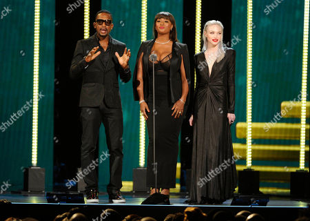 Bill Bellamy, from left, Toccara Jones and Ivy Levan speak on stage during the 2014 Soul Train Awards at Orleans Arena, in Las Vegas