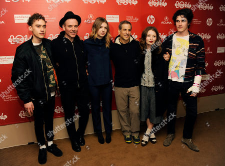 """Stuart Murdoch, second from left, writer/director of """"God Help the Girl,"""" poses with, from left, cast members Olly Alexander and Hannah Murray, producer Barry Mendel and cast members Emily Browning and Pierre Boulanger at the premiere of the film at the 2014 Sundance Film Festival, in Park City, Utah"""
