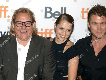 "Kriv Stenders, and from left, Teresa Palmer and Luke Hemsworth arrive at the premiere of ""Kill Me Three Timesl"" on day 3 of the Toronto International Film Festival at the Scotiabank Cinema 2, in Toronto"