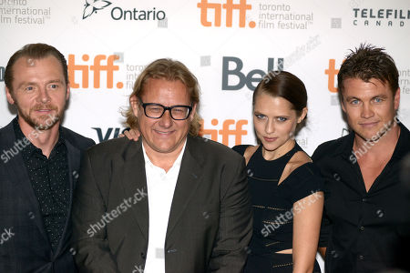 "Simon Pegg, and from left, Kriv Stenders, Teresa Palmer and Luke Hemsworth arrive at the premiere of ""Kill Me Three Timesl"" on day 3 of the Toronto International Film Festival at the Scotiabank Cinema 2, in Toronto"