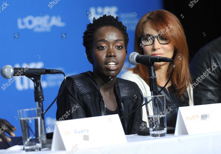 """Kuoth Wiel, left, and Margaret Nagle attend the press conference for """"The Good Lie"""" on day 5 of the Toronto International Film Festival at the TIFF Bell Lightbox, in Toronto"""