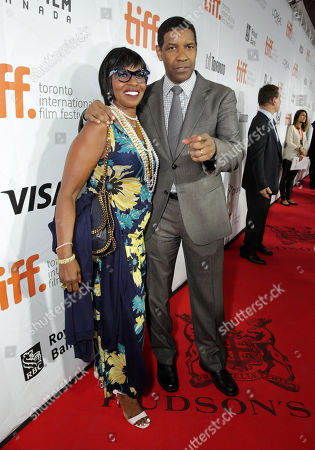 "Stock Photo of Pauletta Pearson Washington and Denzel Washington seen at Columbia Pictures Premiere of ""The Equalizer"" at 2014 TIFF, in Toronto"